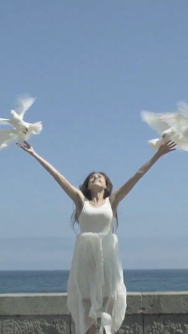 woman releases doves