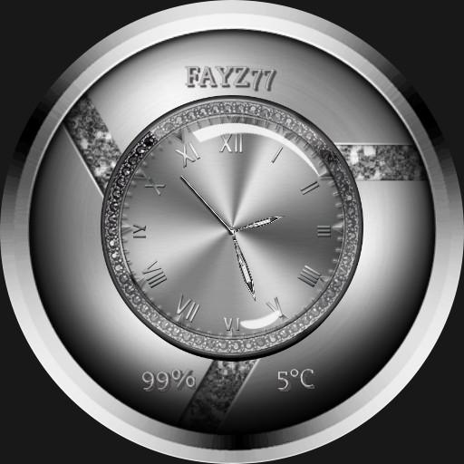 Glitzy silver watch face.