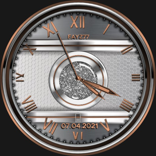 Rose gold and silver watch face.